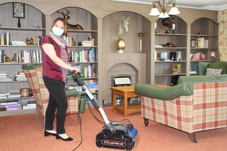 Cleaning machine in a care home